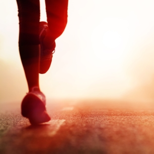 Runner-athlete-feet-running-on-road.-woman-fitness-silhouette-sunrise-jog-workout-wellness-concept.1-rcm992x0