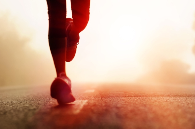 Runner-athlete-feet-running-on-road.-woman-fitness-silhouette-sunrise-jog-workout-wellness-concept.1-rcm992x0
